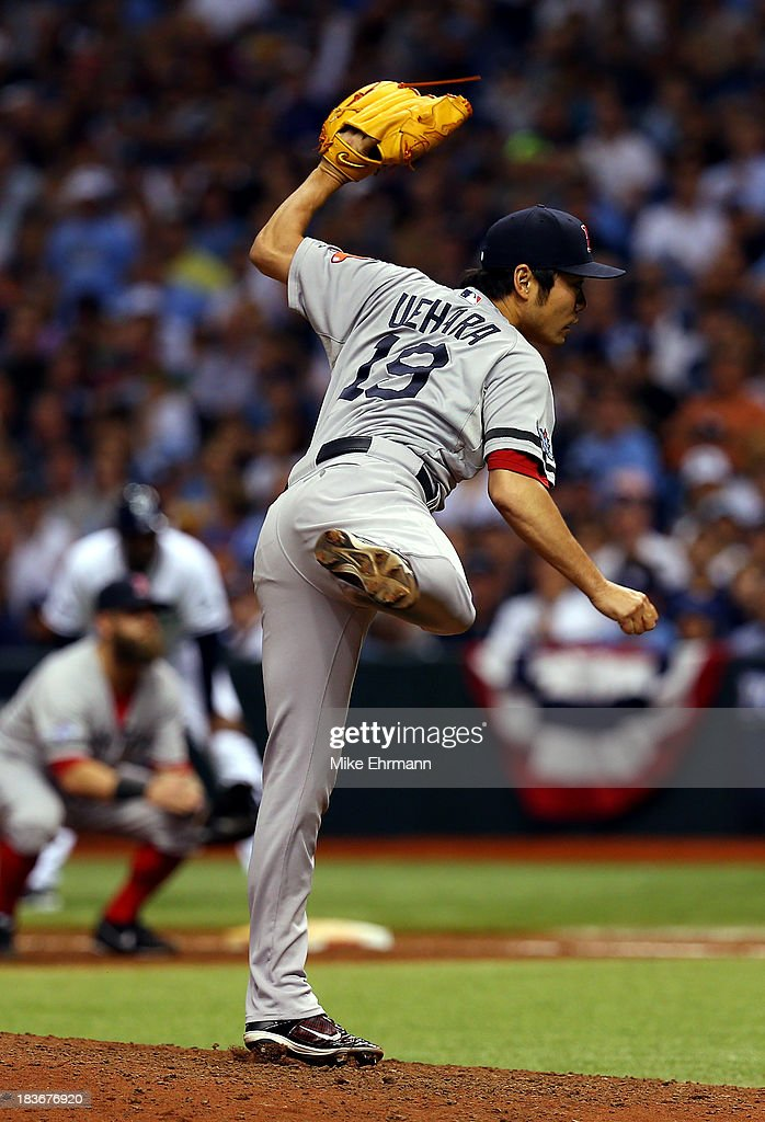 <a gi-track='captionPersonalityLinkClicked' href=/galleries/search?phrase=Koji+Uehara&family=editorial&specificpeople=801278 ng-click='$event.stopPropagation()'>Koji Uehara</a> #19 of the Boston Red Sox pitches against the Tampa Bay Rays in the eighth inning during Game Four of the American League Division Series at Tropicana Field on October 8, 2013 in St Petersburg, Florida.