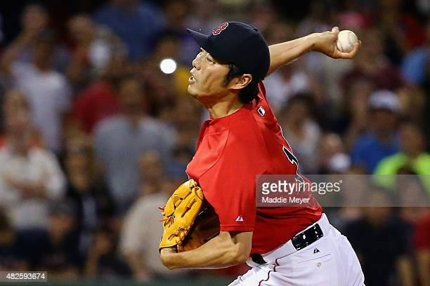 Koji Uehara of the Boston Red Sox pitches against the Tampa Bay Rays during the ninth inning at Fenway Park on July 31 2015 in Boston Massachusetts...