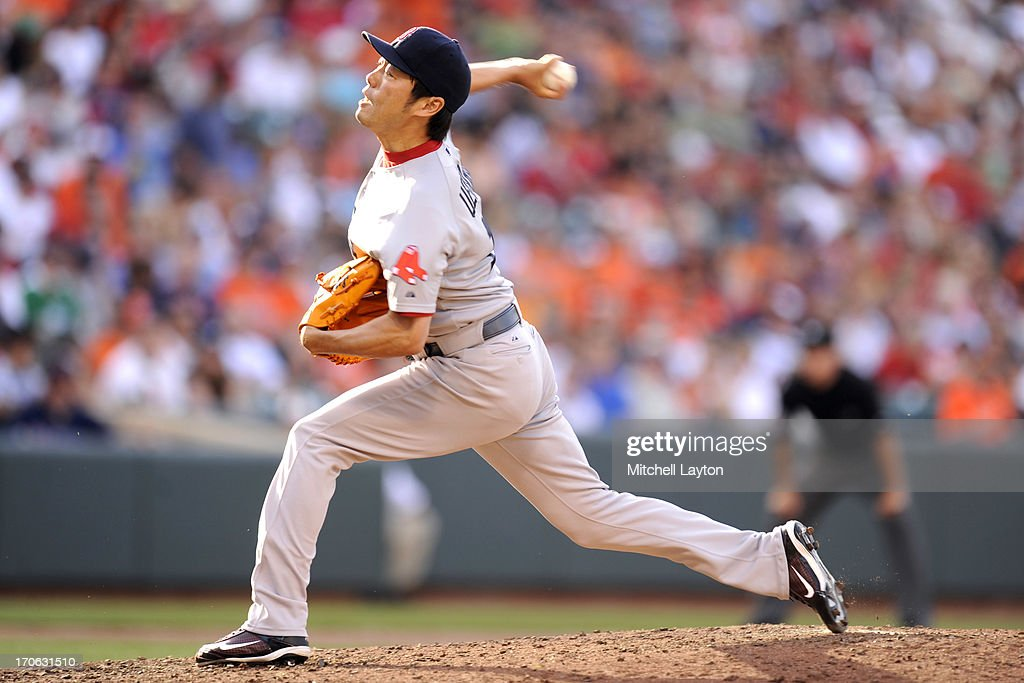 Koji Uehara #19 of the Boston Red Sox pitches during a baseball game against the Baltimore Orioles on June 15, 2013 at Oriole Park at Camden Yards in Baltimore, Maryland. The Red Sox won 5-4.