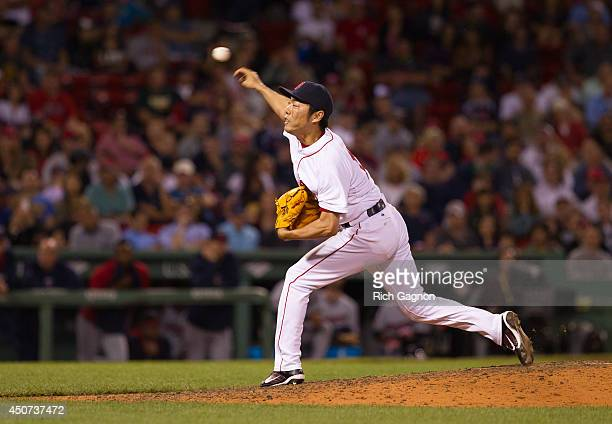 Koji Uehara of the Boston Red Sox pitches during the ninth inning against the Minnesota Twins at Fenway Park on June 16 2014 in Boston Massachusetts...