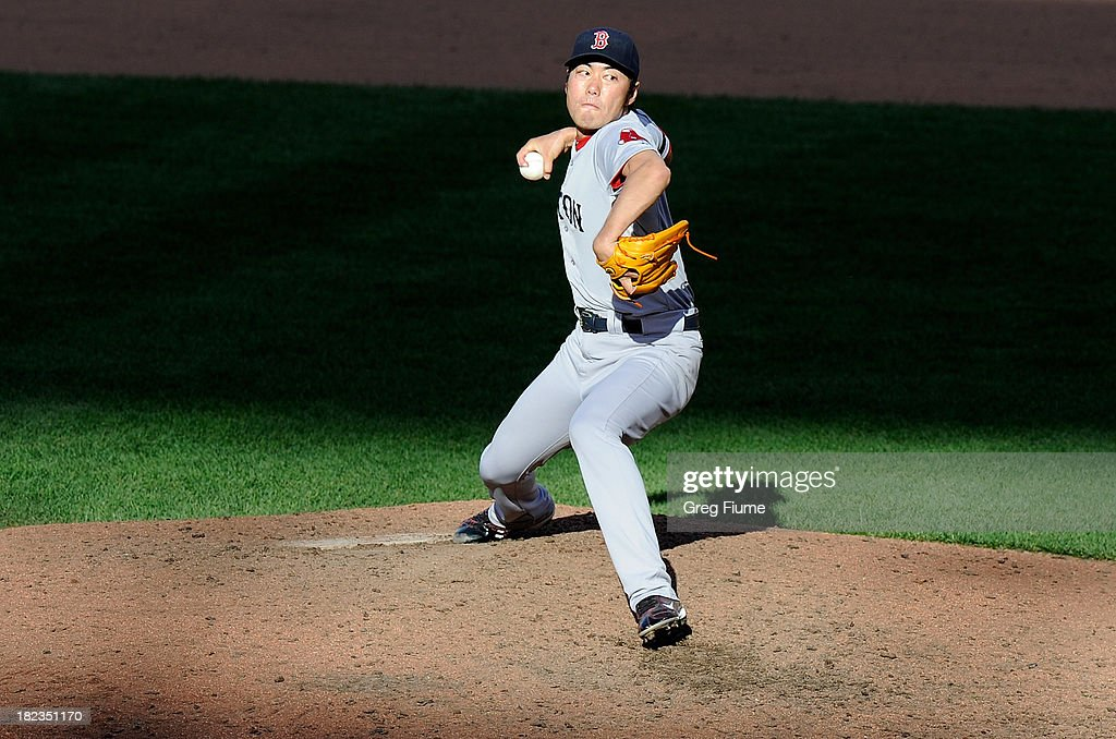 <a gi-track='captionPersonalityLinkClicked' href=/galleries/search?phrase=Koji+Uehara&family=editorial&specificpeople=801278 ng-click='$event.stopPropagation()'>Koji Uehara</a> #19 of the Boston Red Sox pitches in the eighth inning against the Baltimore Orioles at Oriole Park at Camden Yards on September 29, 2013 in Baltimore, Maryland.