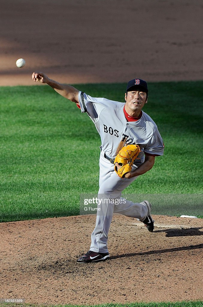 Koji Uehara #19 of the Boston Red Sox pitches in the eighth inning against the Baltimore Orioles at Oriole Park at Camden Yards on September 29, 2013 in Baltimore, Maryland.