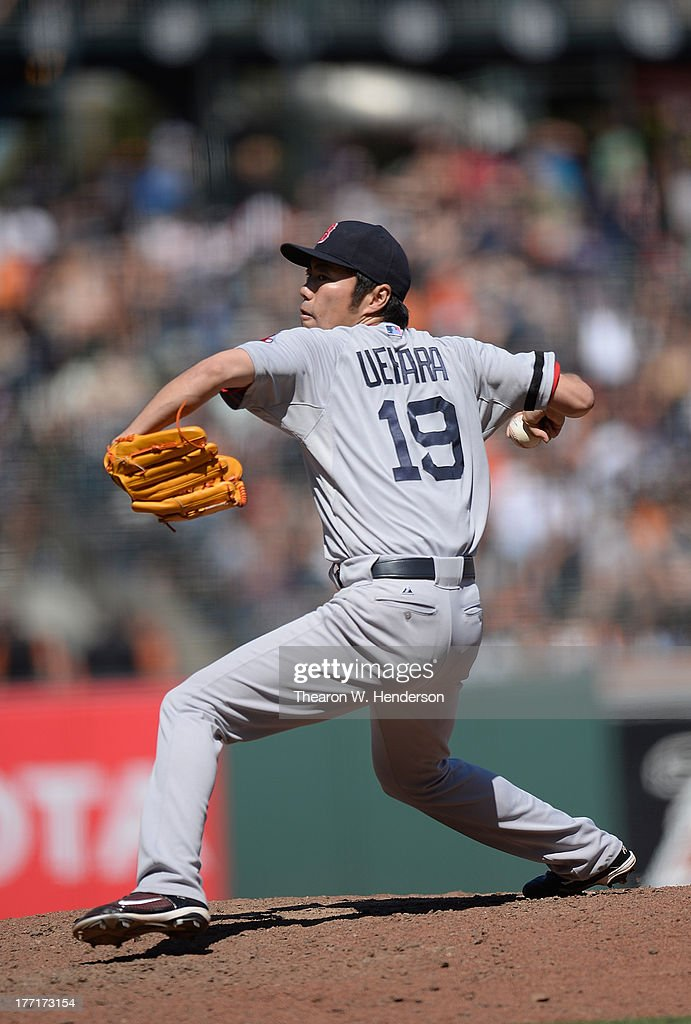 <a gi-track='captionPersonalityLinkClicked' href=/galleries/search?phrase=Koji+Uehara&family=editorial&specificpeople=801278 ng-click='$event.stopPropagation()'>Koji Uehara</a> #19 of the Boston Red Sox pitches in the ninth inning against the San Francisco Giants at AT&T Park on August 21, 2013 in San Francisco, California. The Red Sox won the game 12-1.