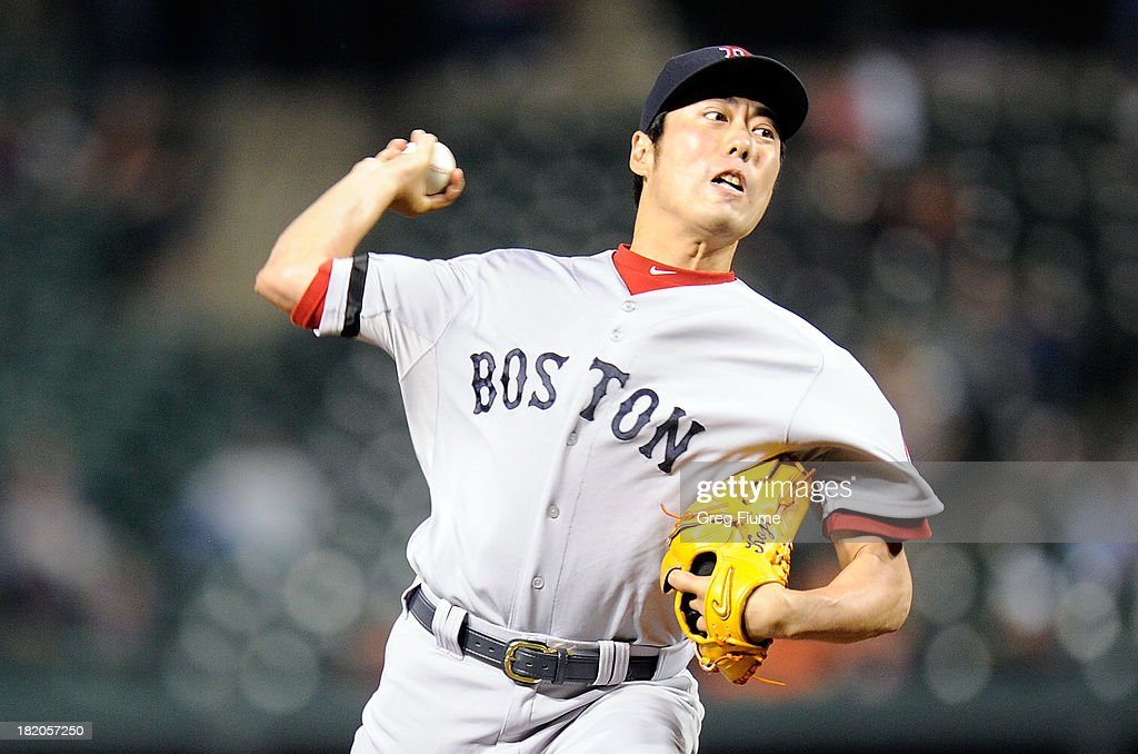 <a gi-track='captionPersonalityLinkClicked' href=/galleries/search?phrase=Koji+Uehara&family=editorial&specificpeople=801278 ng-click='$event.stopPropagation()'>Koji Uehara</a> #19 of the Boston Red Sox pitches in the ninth inning against the Baltimore Orioles at Oriole Park at Camden Yards on September 27, 2013 in Baltimore, Maryland.