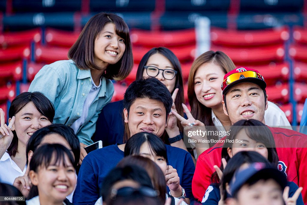 Koji Uehara #19 of the Boston Red Sox poses with fans before a game against the Baltimore Orioles on September 13, 2016 at Fenway Park in Boston, Massachusetts.