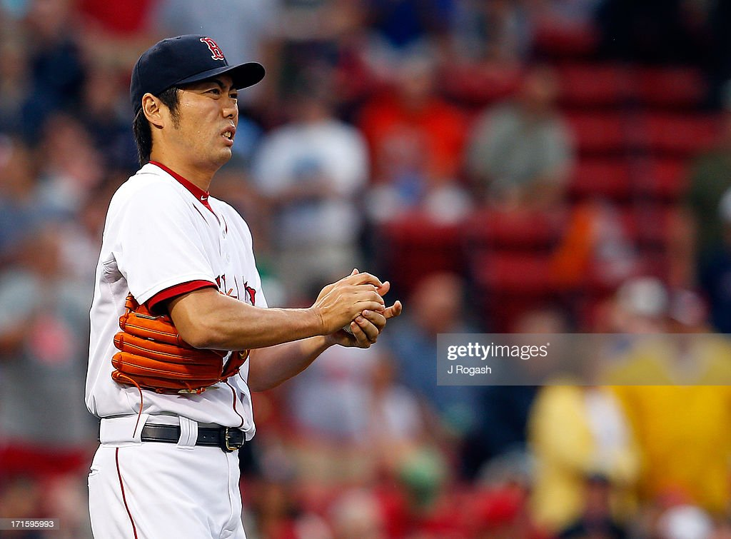 Koji Uehara #19 of the Boston Red Sox prepares to throw against the Colorado Rockies in the 9th inning at Fenway Park on June 26, 2013 in Boston, Massachusetts.