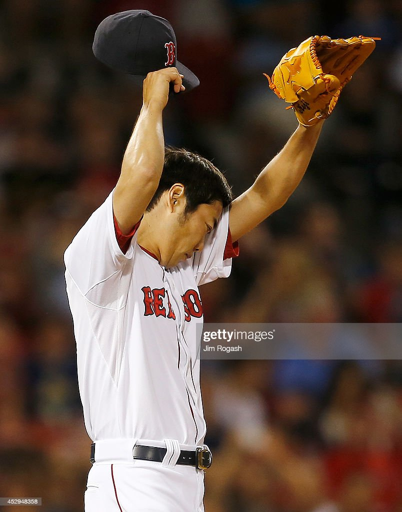<a gi-track='captionPersonalityLinkClicked' href=/galleries/search?phrase=Koji+Uehara&family=editorial&specificpeople=801278 ng-click='$event.stopPropagation()'>Koji Uehara</a> #19 of the Boston Red Sox prepares to throw in the ninth inning against the Toronto Blue Jays at Fenway Park on July 30, 2014 in Boston, Massachusetts.