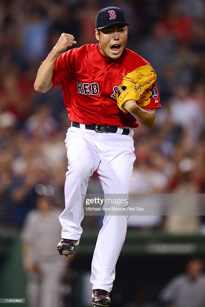Koji Uehara #19 of the Boston Red Sox reacts after completing a save against the New York Yankees in the ninth inning on July 19, 2013 at Fenway Park in Boston, Massachusetts.