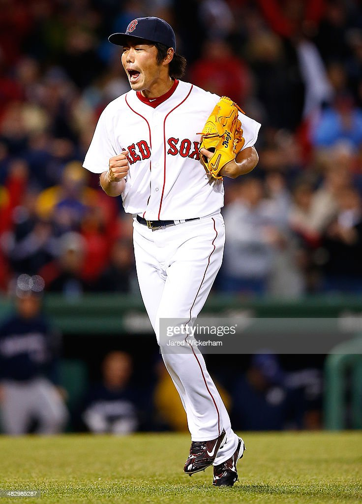 <a gi-track='captionPersonalityLinkClicked' href=/galleries/search?phrase=Koji+Uehara&family=editorial&specificpeople=801278 ng-click='$event.stopPropagation()'>Koji Uehara</a> #19 of the Boston Red Sox reacts after getting out of the 9th inning against the Milwaukee Brewers during the game at Fenway Park on April 5, 2014 in Boston, Massachusetts.