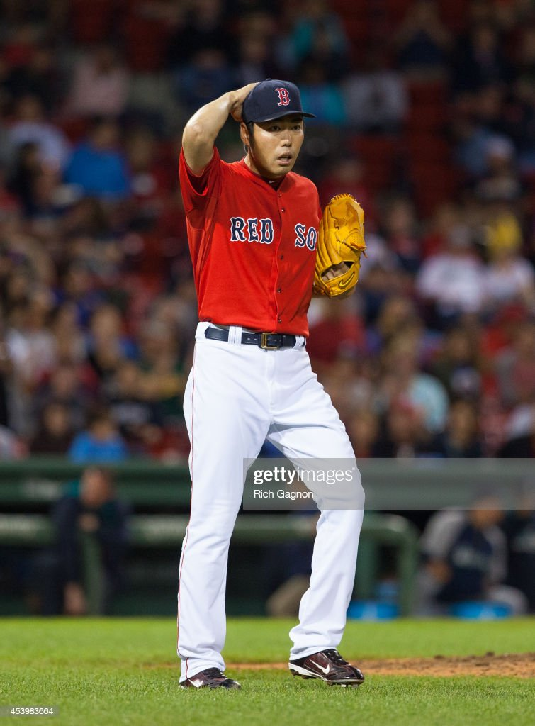 <a gi-track='captionPersonalityLinkClicked' href=/galleries/search?phrase=Koji+Uehara&family=editorial&specificpeople=801278 ng-click='$event.stopPropagation()'>Koji Uehara</a> #19 of the Boston Red Sox reacts after giving up 5 runs during the ninth inning against the Seattle Mariners at Fenway Park after leading 3-0 on August 22, 2014 in Boston, Massachusetts.