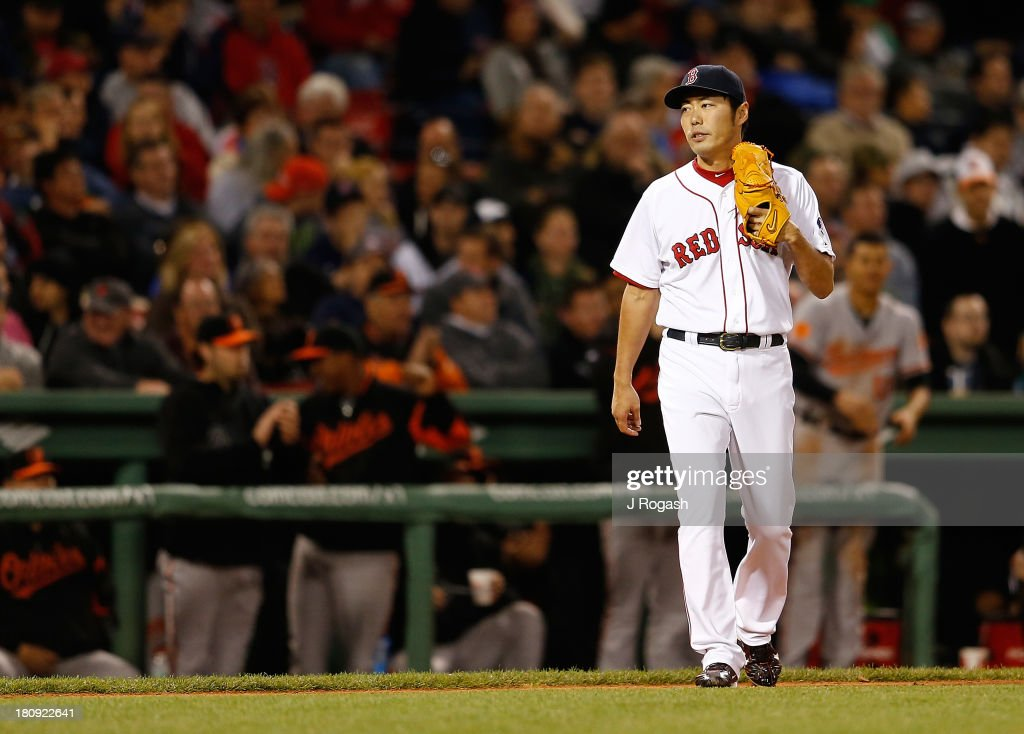 Koji Uehara #19 of the Boston Red Sox reacts after giving up a triple to Danny Valencia #35 of the Baltimore Orioles in the 9th inning at Fenway Park on September 17 in Boston, Massachusetts.