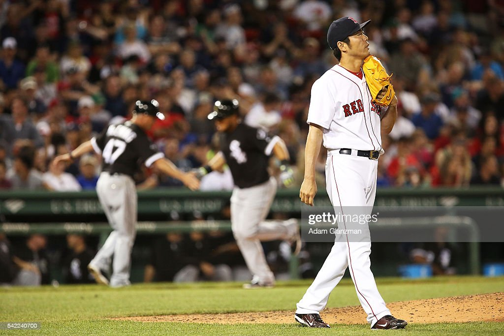 Koji Uehara #19 of the Boston Red Sox reacts after giving up a two-run home run to Melky Cabrera #53 of the Chicago White Sox in the eighth inning during the game at Fenway Park on June 22, 2016 in Boston, Massachusetts.