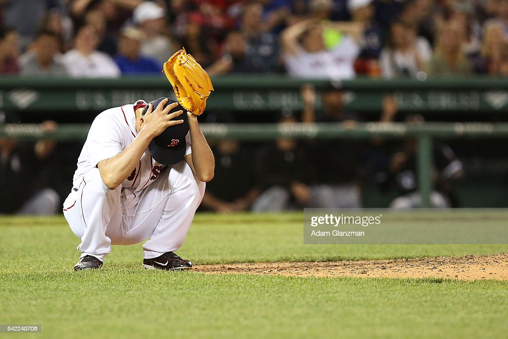 Koji Uehara #19 of the Boston Red Sox reacts after giving up a two-run home run to Melky Cabrera #53 of the Chicago White Sox in the eighth inning during the game against the Chicago White Sox at Fenway Park on June 22, 2016 in Boston, Massachusetts.