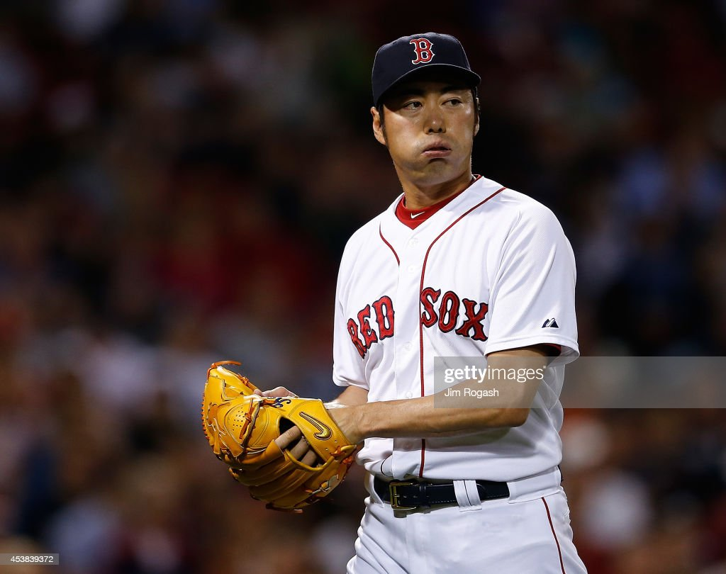 <a gi-track='captionPersonalityLinkClicked' href=/galleries/search?phrase=Koji+Uehara&family=editorial&specificpeople=801278 ng-click='$event.stopPropagation()'>Koji Uehara</a> #19 of the Boston Red Sox reacts after giving up the go-ahead run in the ninth inning against the Los Angeles Angels of Anaheim at Fenway Park on August 19, 2014 in Boston, Massachusetts.