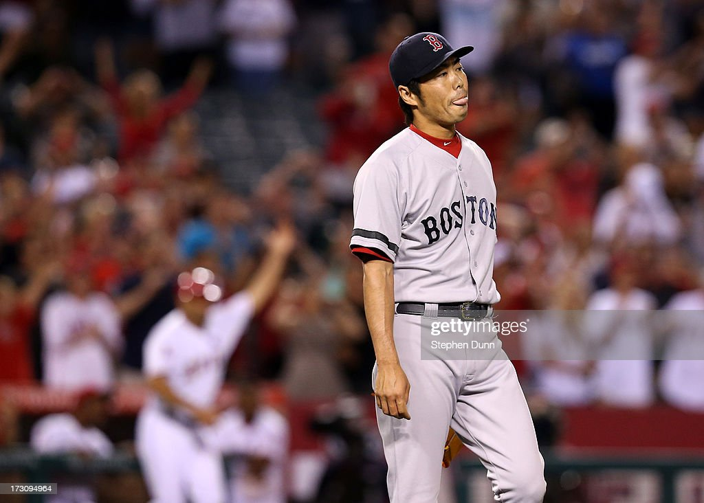 <a gi-track='captionPersonalityLinkClicked' href=/galleries/search?phrase=Koji+Uehara&family=editorial&specificpeople=801278 ng-click='$event.stopPropagation()'>Koji Uehara</a> #19 of the Boston Red Sox reacts after givng up a run in the ninth inning against the Los Angeles Angels of Anaheim at Angel Stadium of Anaheim on July 6, 2013 in Anaheim, California.