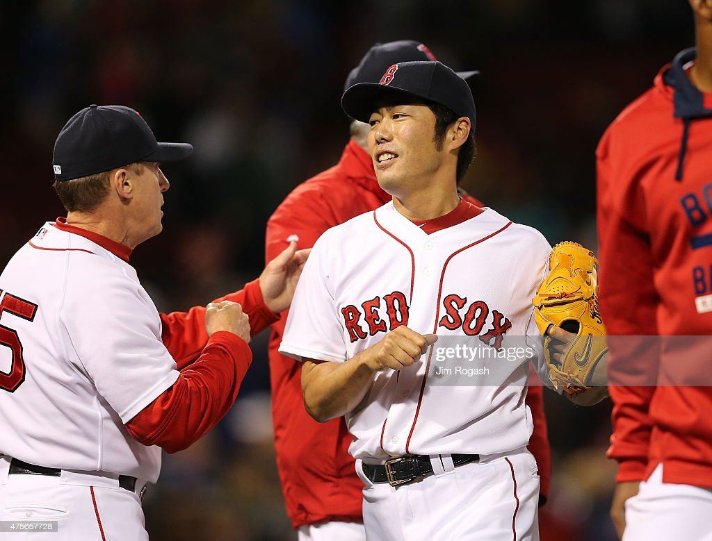 Koji Uehara #19 of the Boston Red Sox reacts after he pitched a scoreless ninth inning against the Minnesota Twins earning the Red Sox a 1-0 win at Fenway Park on June 2, 2015 in Boston, Massachusetts.