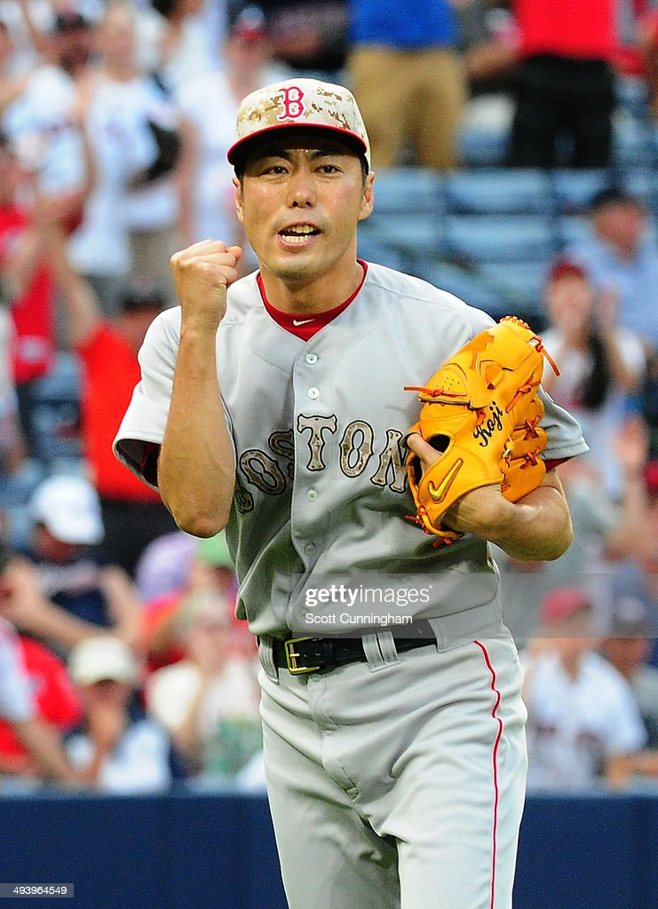 <a gi-track='captionPersonalityLinkClicked' href=/galleries/search?phrase=Koji+Uehara&family=editorial&specificpeople=801278 ng-click='$event.stopPropagation()'>Koji Uehara</a> #19 of the Boston Red Sox reacts after inducing the game-ending double play against the Atlanta Braves at Turner Field on May 26, 2014 in Atlanta, Georgia.