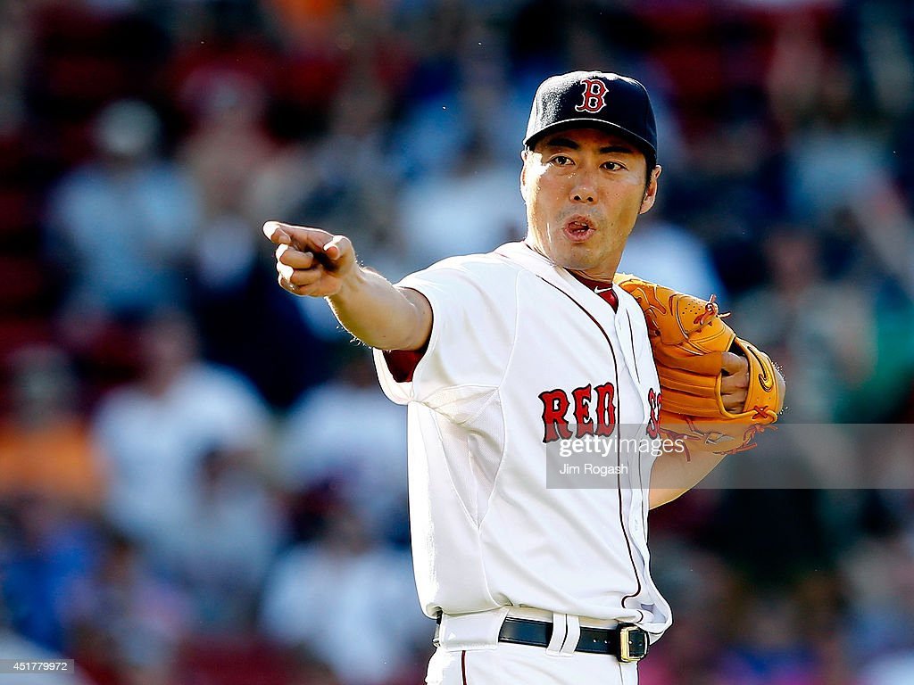 <a gi-track='captionPersonalityLinkClicked' href=/galleries/search?phrase=Koji+Uehara&family=editorial&specificpeople=801278 ng-click='$event.stopPropagation()'>Koji Uehara</a> #19 of the Boston Red Sox reacts after picking off a base runner in the 10th inning against the Baltimore Orioles at Fenway Park on July 6, 2014 in Boston, Massachusetts.