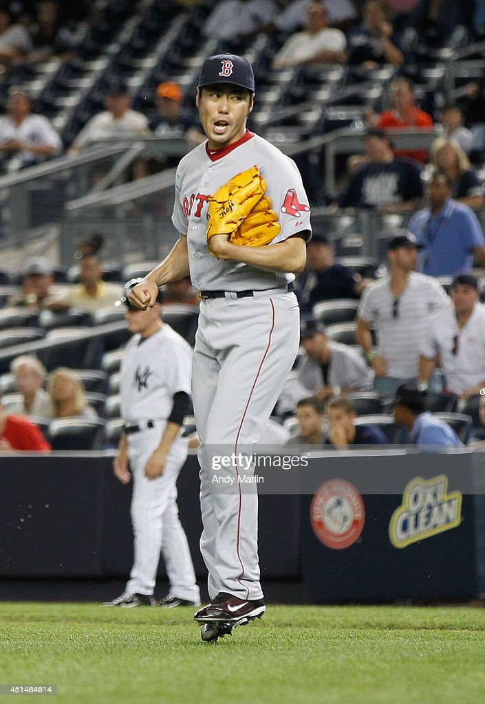 Koji Uehara #19 of the Boston Red Sox reacts after pitching the ninth inning and getting a save against the New York Yankees at Yankee Stadium on June 29, 2014 in the Bronx borough of New York City. The Red Sox defeated the Yankees 8-5.