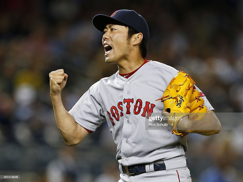 Koji Uehara #19 of the Boston Red Sox reacts after striking out Brian McCann #34 of the New York Yankees in the ninth inning to end the game at Yankee Stadium on June 28, 2014 in the Bronx borough of New York City. The Red Sox defeated the Yankees 2-1.