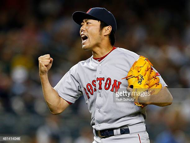 Koji Uehara of the Boston Red Sox reacts after striking out Brian McCann of the New York Yankees in the ninth inning to end the game at Yankee...