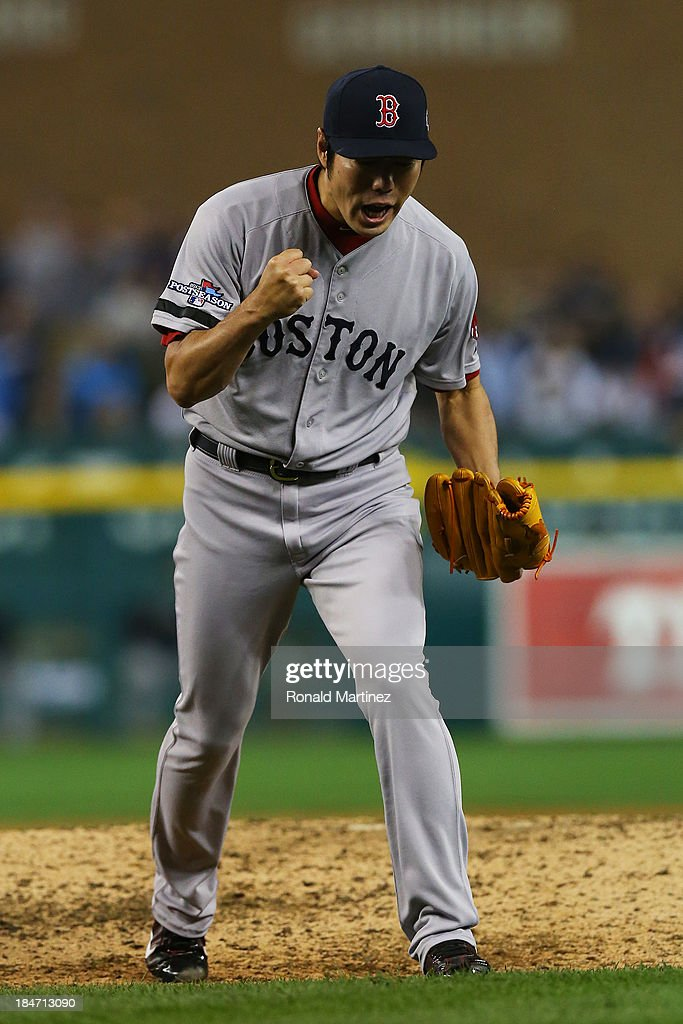 <a gi-track='captionPersonalityLinkClicked' href=/galleries/search?phrase=Koji+Uehara&family=editorial&specificpeople=801278 ng-click='$event.stopPropagation()'>Koji Uehara</a> #19 of the Boston Red Sox reacts after throwing the final strike of their 1 to 0 win over the Detroit Tigers in Game Three of the American League Championship Series at Comerica Park on October 15, 2013 in Detroit, Michigan.