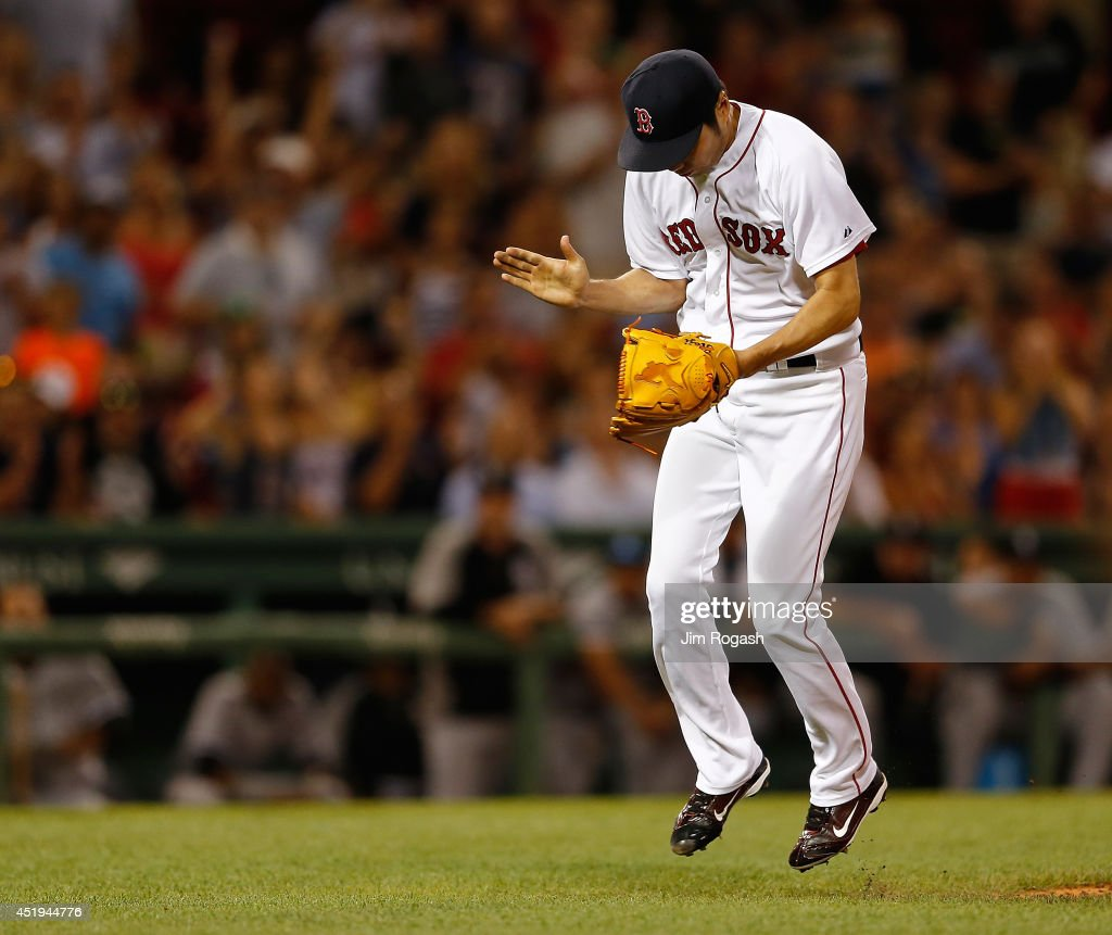 Koji Uehara #19 of the Boston Red Sox reacts against the Chicago White Sox after pitching a scoreless ninth inning at Fenway Park on July 9, 2014 in Boston, Massachusetts.