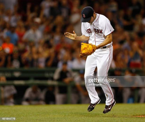 Koji Uehara of the Boston Red Sox reacts against the Chicago White Sox after pitching a scoreless ninth inning at Fenway Park on July 9 2014 in...