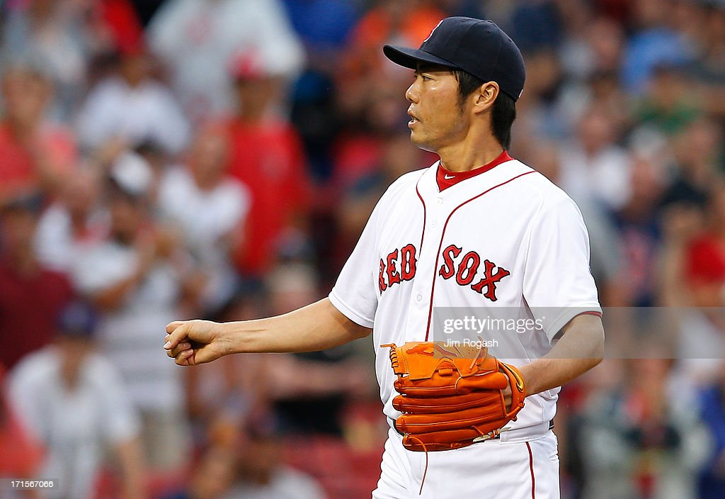 Koji Uehara #19 of the Boston Red Sox reacts against the Colorado Rockies in the 9th inning at Fenway Park on June 26, 2013 in Boston, Massachusetts.