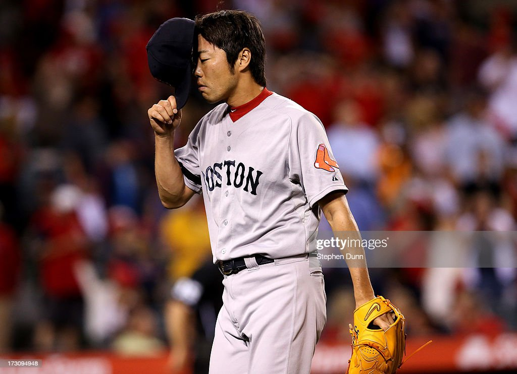 <a gi-track='captionPersonalityLinkClicked' href=/galleries/search?phrase=Koji+Uehara&family=editorial&specificpeople=801278 ng-click='$event.stopPropagation()'>Koji Uehara</a> #19 of the Boston Red Sox reacts as he comes off the field after blowing the save in the ninth inning against the Los Angeles Angels of Anaheim at Angel Stadium of Anaheim on July 6, 2013 in Anaheim, California.