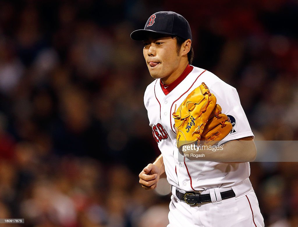 Koji Uehara #19 of the Boston Red Sox reacts as he leaves the mound in the 9th inning after allowing the go-ahead run against the Baltimore Orioles in the 9th inning at Fenway Park on September 17 in Boston, Massachusetts.