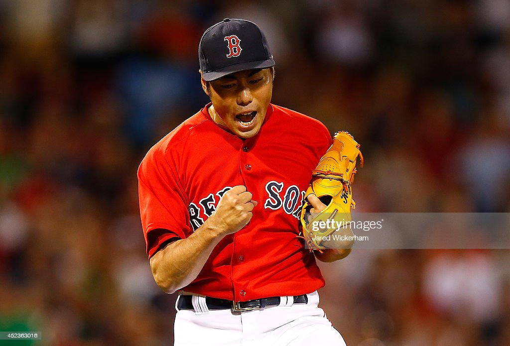 Koji Uehara #19 of the Boston Red Sox reacts following the 5-4 win against the Kansas City Royals in the 9th inning during the game at Fenway Park on July 18, 2014 in Boston, Massachusetts.