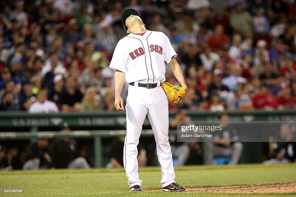 Koji Uehara #19 of the Boston Red Sox reacts in the eighth inning during the game against the Chicago Wite Sox at Fenway Park on June 22, 2016 in Boston, Massachusetts.
