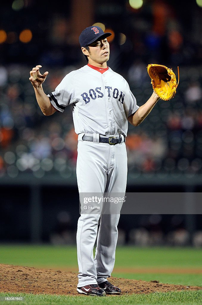 <a gi-track='captionPersonalityLinkClicked' href=/galleries/search?phrase=Koji+Uehara&family=editorial&specificpeople=801278 ng-click='$event.stopPropagation()'>Koji Uehara</a> #19 of the Boston Red Sox reacts to a call in the ninth inning against the Baltimore Orioles at Oriole Park at Camden Yards on September 27, 2013 in Baltimore, Maryland.