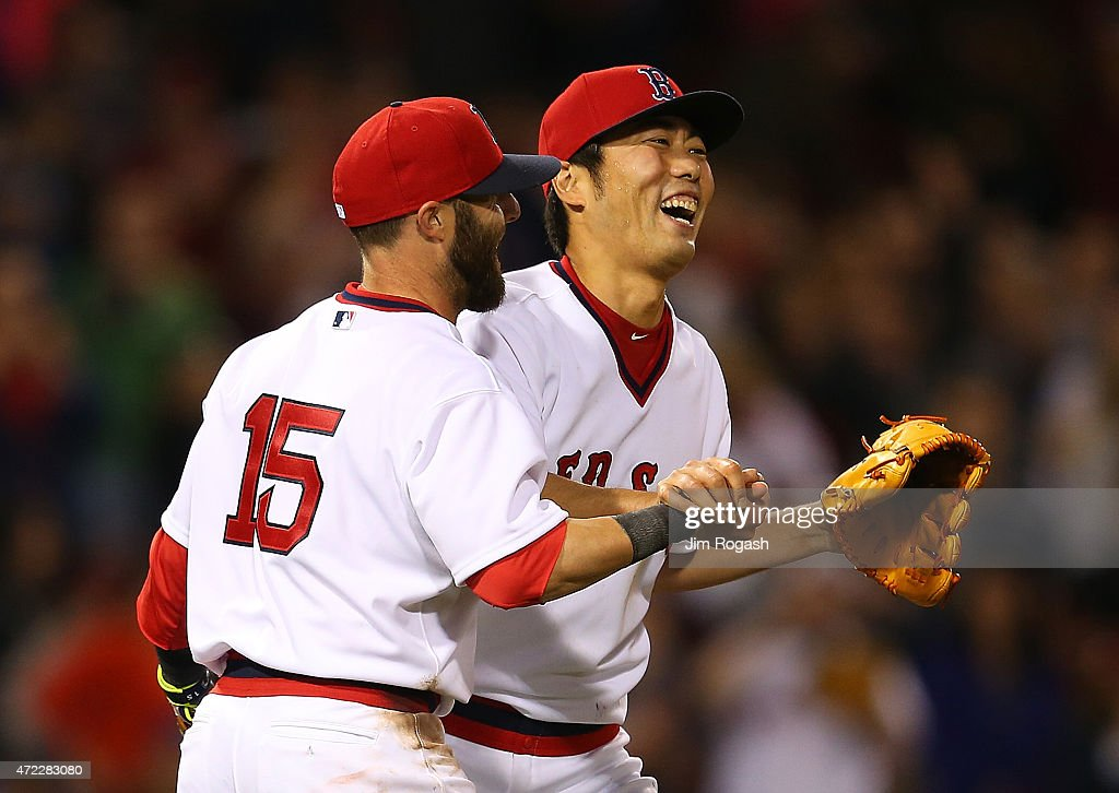 <a gi-track='captionPersonalityLinkClicked' href=/galleries/search?phrase=Koji+Uehara&family=editorial&specificpeople=801278 ng-click='$event.stopPropagation()'>Koji Uehara</a> #19 of the Boston Red Sox reacts with <a gi-track='captionPersonalityLinkClicked' href=/galleries/search?phrase=Dustin+Pedroia&family=editorial&specificpeople=836339 ng-click='$event.stopPropagation()'>Dustin Pedroia</a> #15 after he pitched a scoreless ninth inning to beat Tampa Bay Rays 2-0 at Fenway Park May 5, 2015 in Boston, Massachusetts.