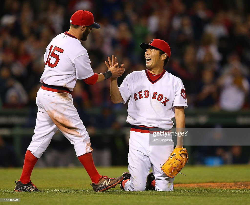 Koji Uehara #19 of the Boston Red Sox reacts with Dustin Pedroia #15 after he pitched a scoreless ninth inning to beat Tampa Bay Rays 2-0 at Fenway Park May 5, 2015 in Boston, Massachusetts.