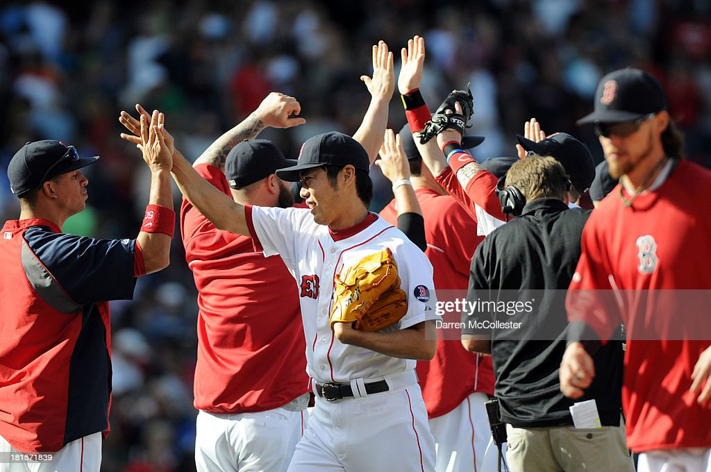 <a gi-track='captionPersonalityLinkClicked' href=/galleries/search?phrase=Koji+Uehara&family=editorial&specificpeople=801278 ng-click='$event.stopPropagation()'>Koji Uehara</a> #19 of the Boston Red Sox slaps high fives with teamates following their win against the Toronto Blue Jays at Fenway Park on September 22, 2013 in Boston, Massachusetts. The Red Sox won the game 5-2.