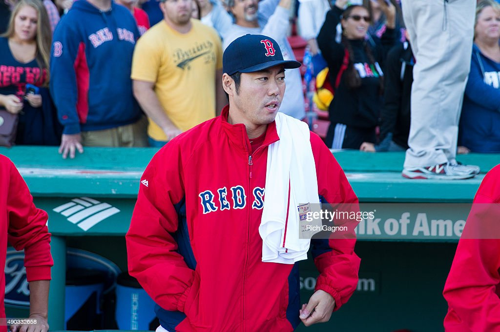 Koji Uehara #19 of the Boston Red Sox stands outside the dugout after a 2-0 victory against the Baltimore Orioles at Fenway Park on September 27, 2015 in Boston, Massachusetts.
