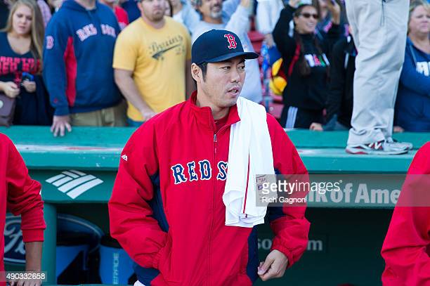 Koji Uehara of the Boston Red Sox stands outside the dugout after a 20 victory against the Baltimore Orioles at Fenway Park on September 27 2015 in...