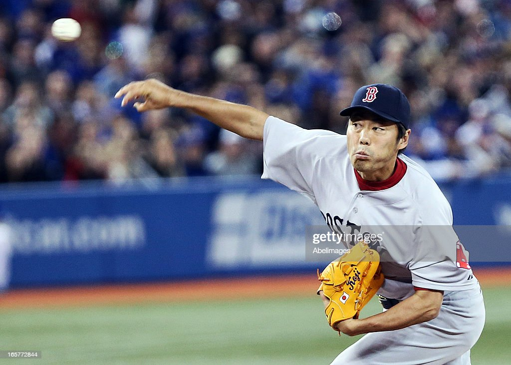 Koji Uehara #19 of the Boston Red Sox throws a pitch in the 6th inning against the Toronto Blue Jays during MLB action at the Rogers Centre April 5, 2013 in Toronto, Ontario, Canada.