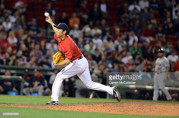 Koji Uehara of the Boston Red Sox throws a pitch in the eighth inning against the Houston Astros at Fenway Park on August 15 2014 in Boston...