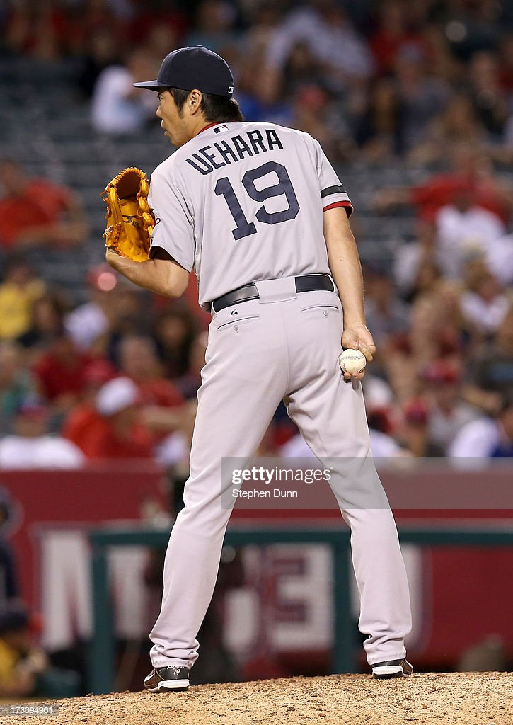 <a gi-track='captionPersonalityLinkClicked' href=/galleries/search?phrase=Koji+Uehara&family=editorial&specificpeople=801278 ng-click='$event.stopPropagation()'>Koji Uehara</a> #19 of the Boston Red Sox throws a pitch in the ninth inning against the Los Angeles Angels of Anaheim at Angel Stadium of Anaheim on July 6, 2013 in Anaheim, California.