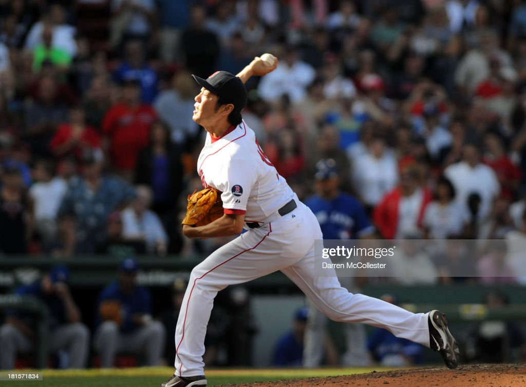 <a gi-track='captionPersonalityLinkClicked' href=/galleries/search?phrase=Koji+Uehara&family=editorial&specificpeople=801278 ng-click='$event.stopPropagation()'>Koji Uehara</a> #19 of the Boston Red Sox throws a pitch in the ninth inning against the Toronto Blue Jays at Fenway Park on September 22, 2013 in Boston, Massachusetts. The Red Sox won the game 5-2