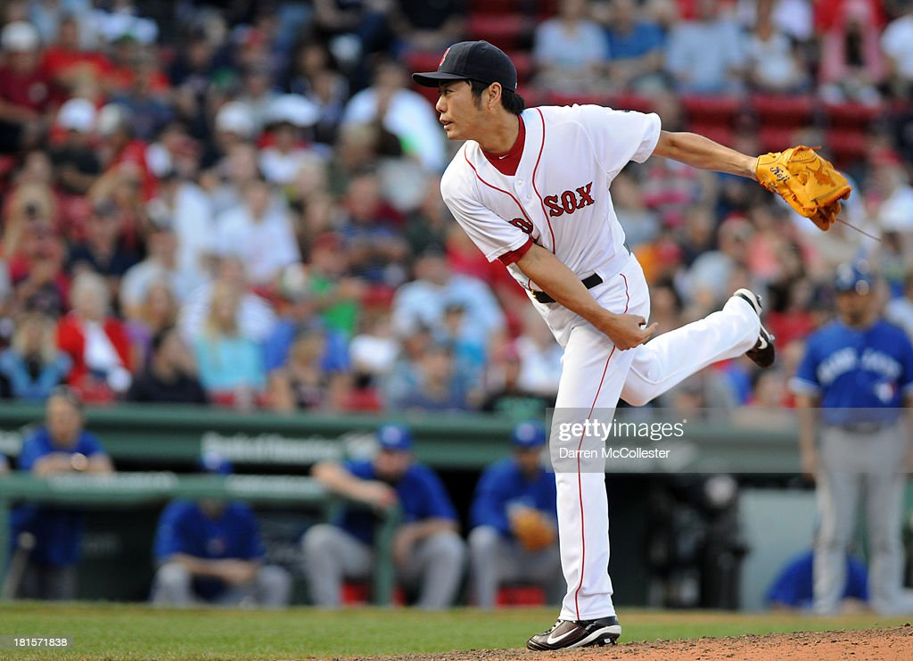<a gi-track='captionPersonalityLinkClicked' href=/galleries/search?phrase=Koji+Uehara&family=editorial&specificpeople=801278 ng-click='$event.stopPropagation()'>Koji Uehara</a> #19 of the Boston Red Sox throws a pitch in the ninth inning against the Toronto Blue Jays at Fenway Park on September 22, 2013 in Boston, Massachusetts. The Red Sox won the game 5-2.