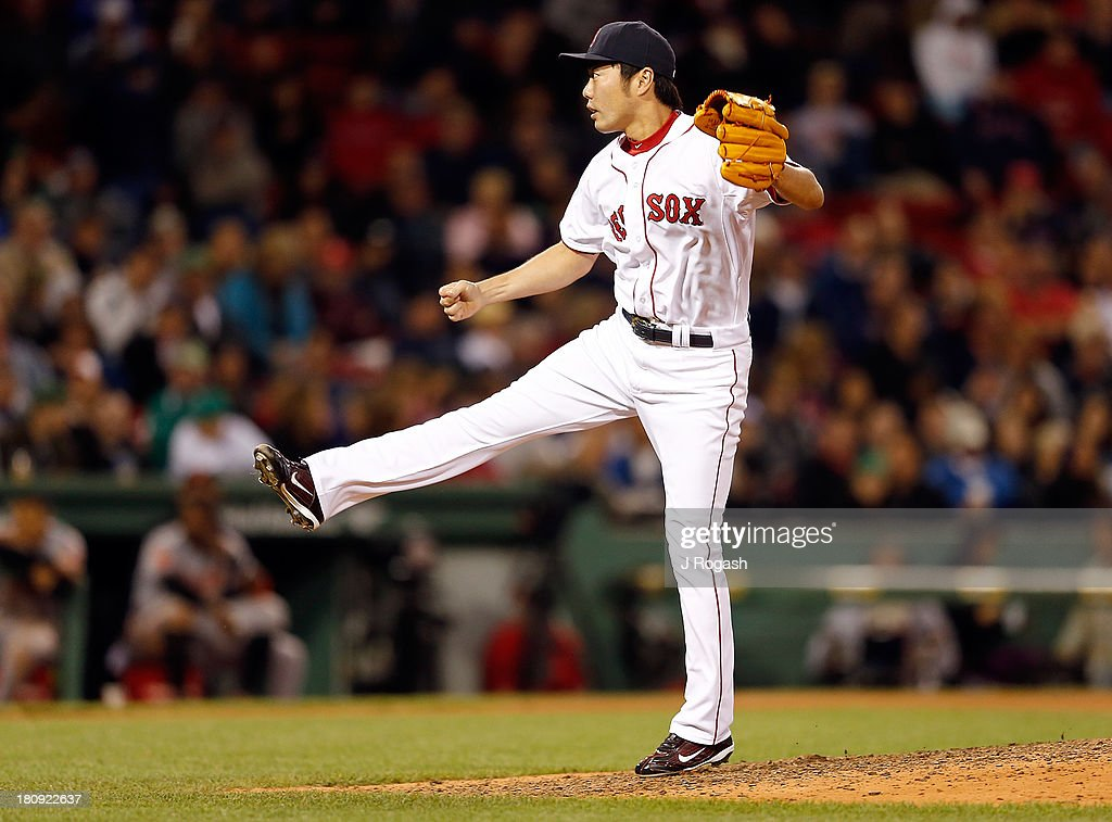 Koji Uehara #19 of the Boston Red Sox throws against the Baltimore Orioles in the 9th inning at Fenway Park on September 17 in Boston, Massachusetts.