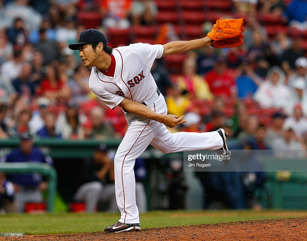 Koji Uehara #19 of the Boston Red Sox throws against the Colorado Rockies in the 9th inning at Fenway Park on June 26, 2013 in Boston, Massachusetts.