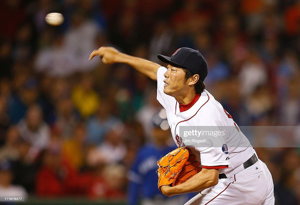 <a gi-track='captionPersonalityLinkClicked' href=/galleries/search?phrase=Koji+Uehara&family=editorial&specificpeople=801278 ng-click='$event.stopPropagation()'>Koji Uehara</a> #19 of the Boston Red Sox throws in the 9th inning against the Toronto Blue Jays at Fenway Park on June 27, 2013 in Boston, Massachusetts.