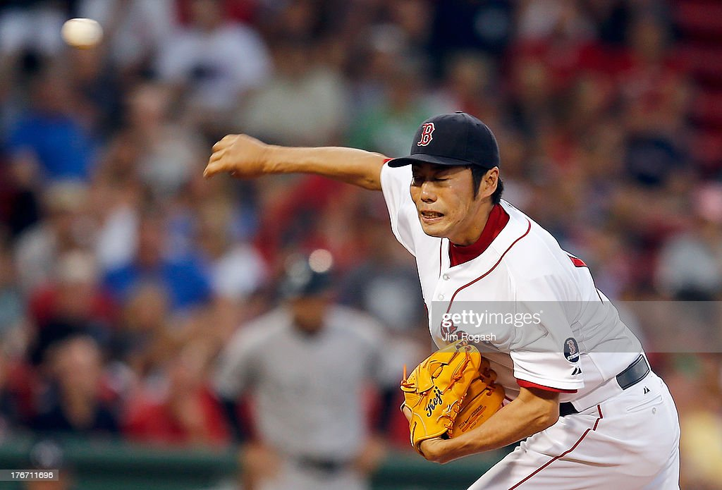 <a gi-track='captionPersonalityLinkClicked' href=/galleries/search?phrase=Koji+Uehara&family=editorial&specificpeople=801278 ng-click='$event.stopPropagation()'>Koji Uehara</a> #19 of the Boston Red Sox throws in the 9th inning against the New York Yankees at Fenway Park on August 17, 2013 in Boston, Massachusetts.