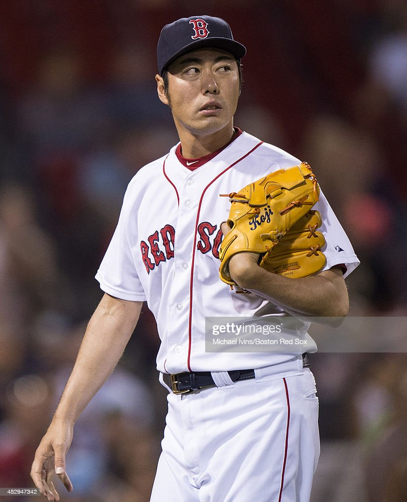 Koji Uehara #19 of the Boston Red Sox walks off the mound after pitching against the Toronto Blue Jays in the ninth inning on July 30, 2014 at Fenway Park in Boston, Massachusetts. Photo by Michael Ivins/Boston Red Sox/Getty Images)