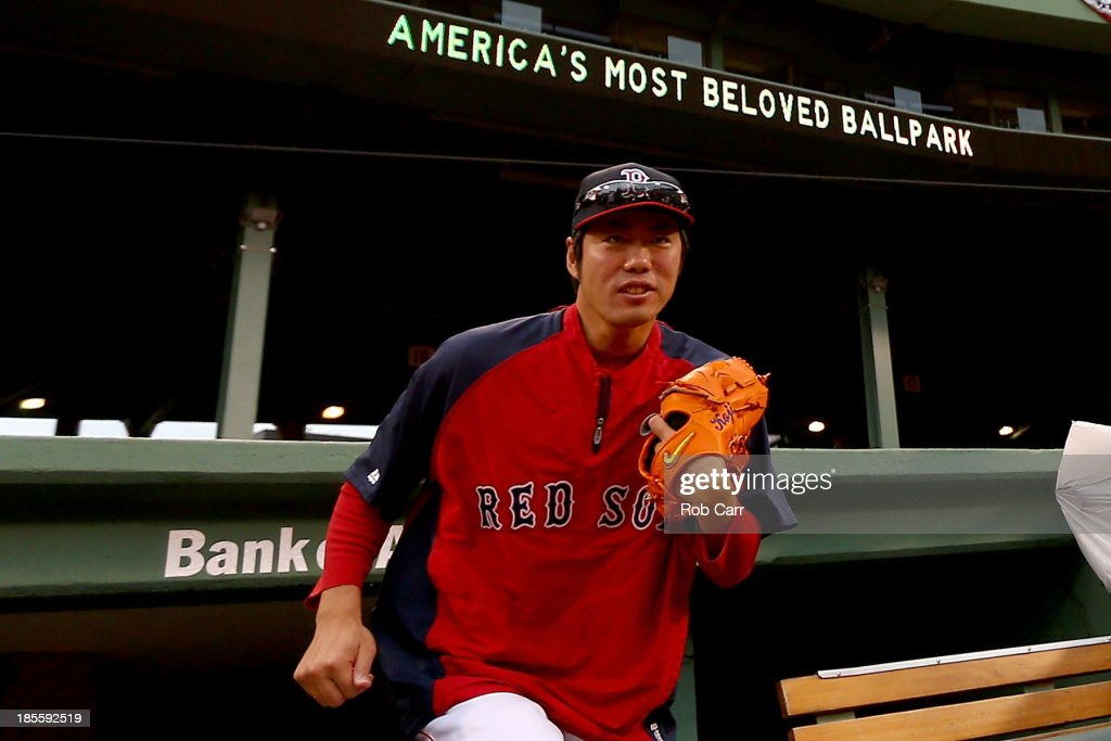 <a gi-track='captionPersonalityLinkClicked' href=/galleries/search?phrase=Koji+Uehara&family=editorial&specificpeople=801278 ng-click='$event.stopPropagation()'>Koji Uehara</a> #19 of the Boston Red Sox walks out of the dugout during team workouts in the 2013 World Series Media Day at Fenway Park on October 22, 2013 in Boston, Massachusetts. The Red Sox host the Cardinals in Game 1 on October 23, 2013.